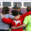 Ayer FF John Delcore, speaks with mock train crash victims as they comfort each other, L-R, Meaghann Ackerman, 20, her sister Ashley Ackerman,23, and Nicole Patterson, 20, all from Littleton. Nashoba Valley Voice Photo by David H. Brow