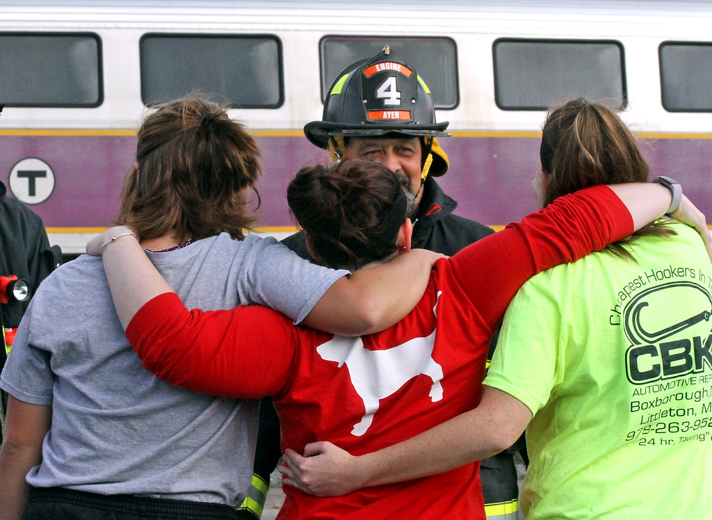 . Ayer FF John Delcore, speaks with mock train crash victims as they comfort each other, L-R, Meaghann Ackerman, 20, her sister Ashley Ackerman,23, and Nicole Patterson, 20, all from Littleton. Nashoba Valley Voice Photo by David H. Brow