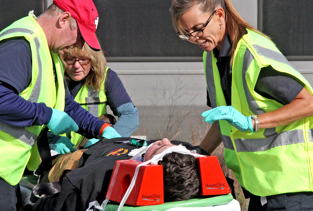 . Harvard EMT\'s L-R, Chris Mitchell, Judy Mitchell (Chris\'s wife), and Kathy Williams treat a victim of the mock train crash in Ayer. Nashoba Valley Voice Photo by David H. Brow