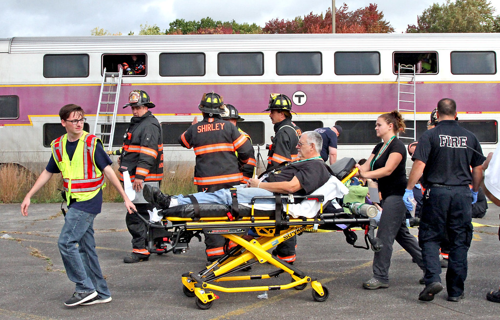 . ER personal and firefighters deal with mock train crash victims. Nashoba Valley Voice Photo by David H. Brow
