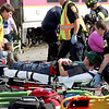 Victims are treated at the scene of a mock train crash in the PanAm railroad yard in Ayer. Nashoba Valley Voice Photo by David H. Brow