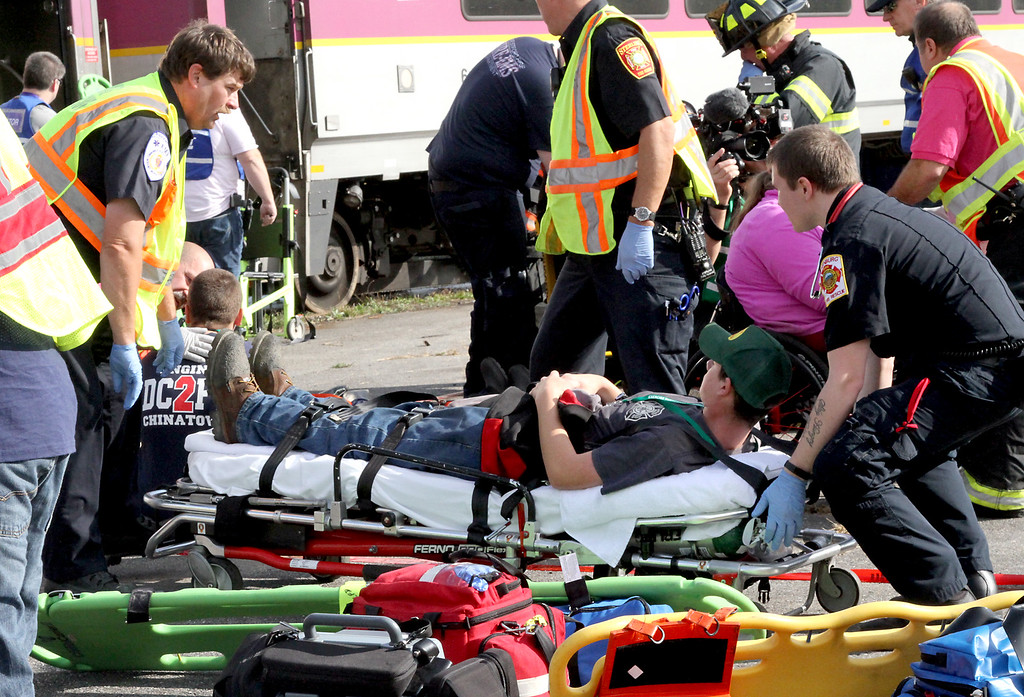 . Victims are treated at the scene of a mock train crash in the PanAm railroad yard in Ayer. Nashoba Valley Voice Photo by David H. Brow