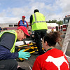 Harvard EMT Chris Mitchell talks to mock train crash victim Ashley Ackerman,23 of Littleton at the PanAm railroad yard in Ayer. Nashoba Valley Voice Photo by David H. Brow