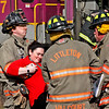 Littleton firefighters carry mock train crash victim, Ashley Ackerman,23, also from Littleton away from the train crash site. Nashoba Valley Voice Photo by David H. Brow