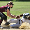 (06/03/18) Ayer/Shirley in-fielder Molly Cadogan (left) misses the catch to tag out St/ Bernard's base runner Lyssa Hoyt during Sunday's varsity softball game at St. Bernard's in Fitchburg.  SENTINEL & ENTERPRISE JEFF PORTER
