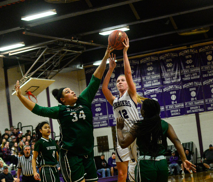 KRISTOPHER RADDER — BRATTLEBORO REFORMER<br /> Bellows Falls' Taylor Goodell tries for a basket but is blocked by Winooski's Kiara Mack during a playoff game at Bellows Falls Union High School on Tuesday, March 3, 2020.