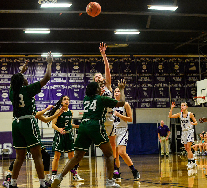 KRISTOPHER RADDER — BRATTLEBORO REFORMER<br /> Bellows Falls' Taylor Goodell makes her 1000 career point while being covered by Winooski's Amina Osman during a playoff game at Bellows Falls Union High School on Tuesday, March 3, 2020.