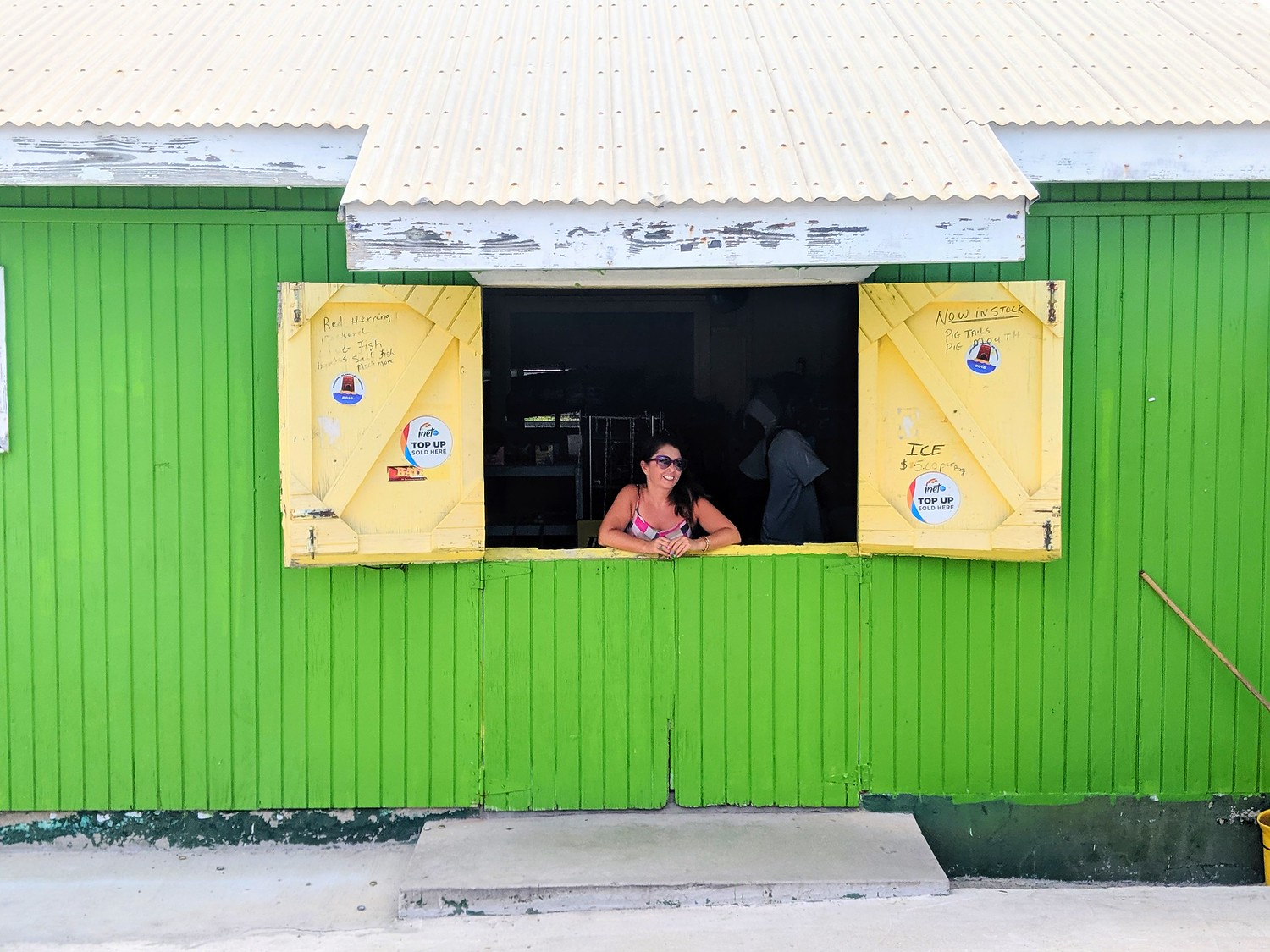 Ayngelina looking out a convenience store in Antigua