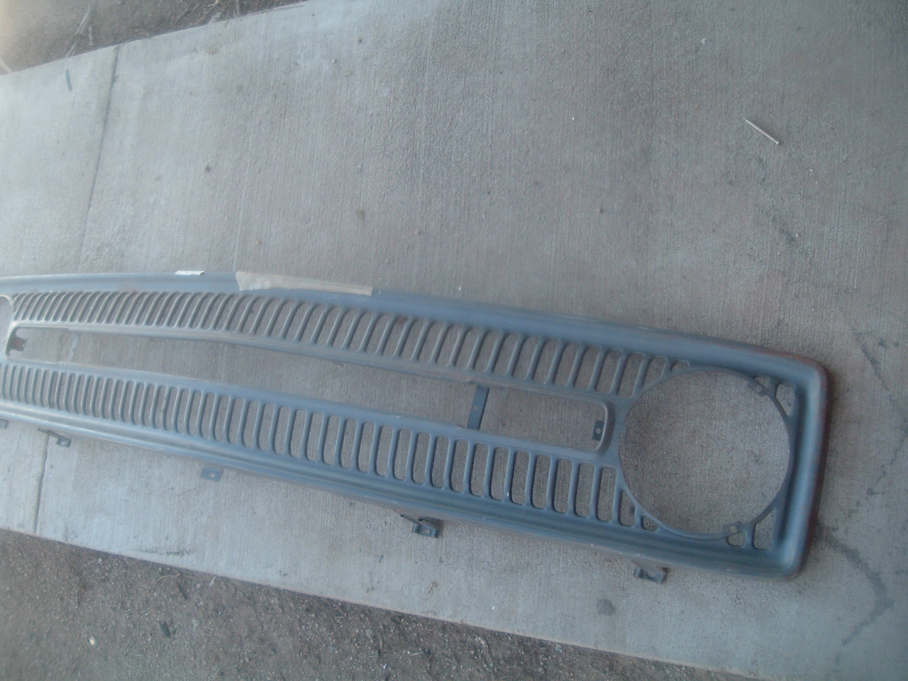 1953 Plymouth Left Lower Grille Moulding Mopar NOS # 1494263 Early