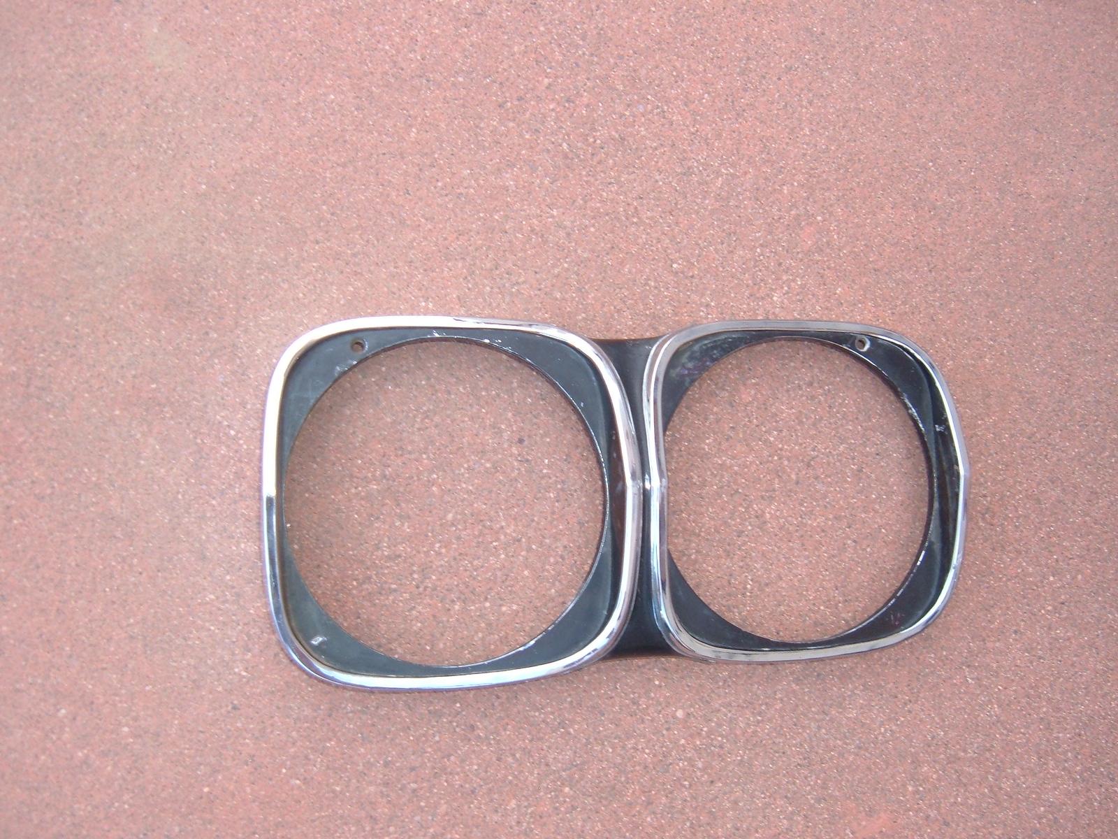 1966 oldsmobile headlight bezel nos gm 391245 (z 391245)