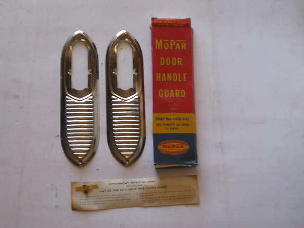 1953 Dodge Plymouth NOS door handle guard accessory # 1450441 (zd 1450441)