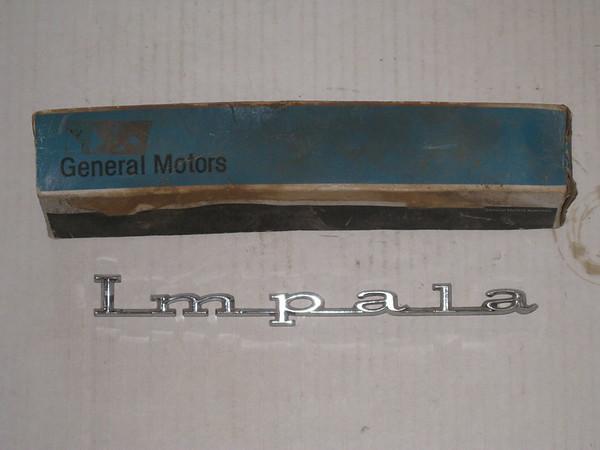1967 Chevrolet Impala NOS rear quarter panel emblem Impala # 4229431