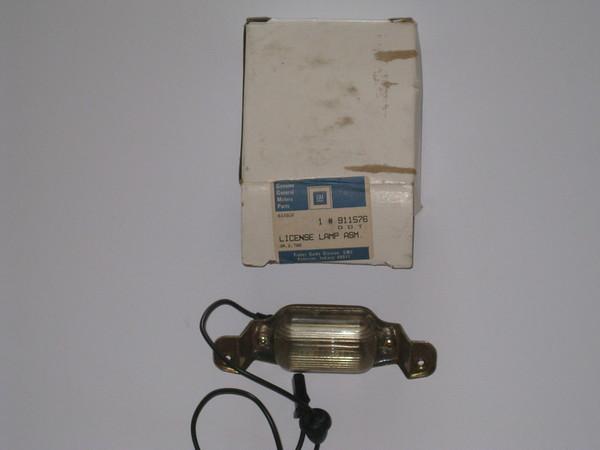 1966 67 68 69 70 71 72 Chevrolet Pontiac Oldsmobile NOS rear license plate lamp assembly # 911576