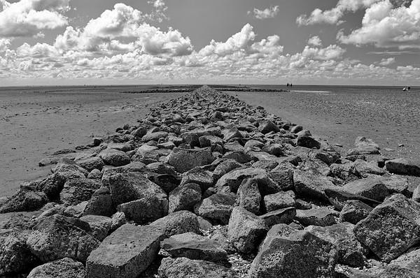Groyne extending into the Wadden Sea (b/w)