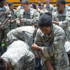 Drill sergeants from Bravo Company, 1st Battalion, 46th Infantry Regiment at Fort Benning, Georgia, teach Junior Reserve Officers' Training Corps cadets drown proofing techniques at the Briant Wells Indoor Pool June 7 on post. The event was a part of the weeklong JROTC Cadet Leadership Challenge Camp. (U.S. Army photos by Megan Garcia, Fort Benning, Maneuver Center of Excellence Public Affairs)