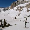 Jeff climbs the slopes above Cascade Lake