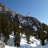 The arrow shows the harrowing cliffbanded slope we ended up descending before ending up in the proper gully. Mea Culpa.
