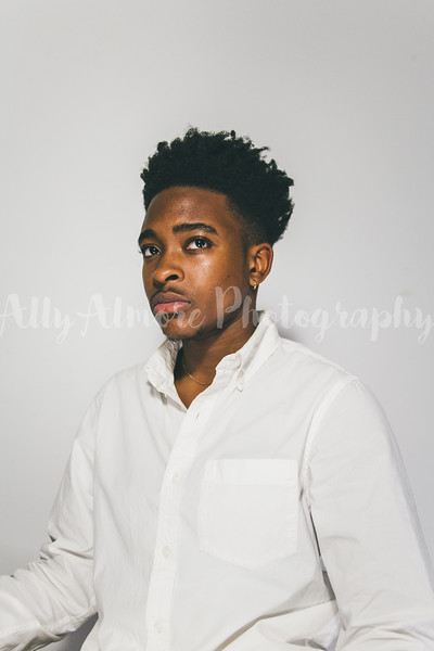 CJ on White,  - pictured with a style of watermark that your first gallery preview will have while you select your final images
