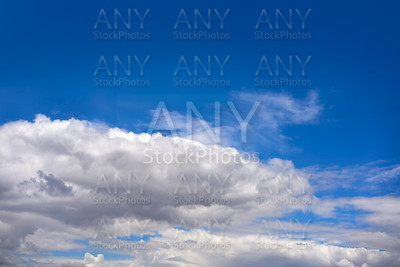 Blue summer sky with cumulus clouds