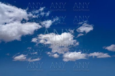 cumulus clouds perfect white in blue sky