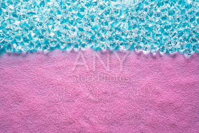Pink beach sand background with aqua