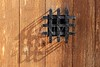 ancient window black metal jail grid wooden door
