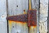 rusty aged iron hinge weathered gray wood door