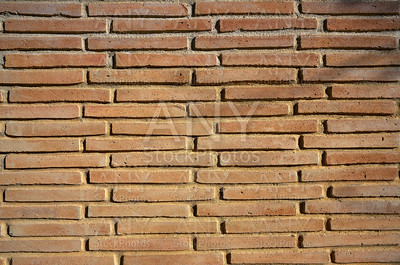 Brickwall texture detail in ocher color