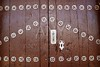 Anciend wood door with metal silver decoration