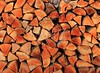 firewood wood pile stacked triangle shape
