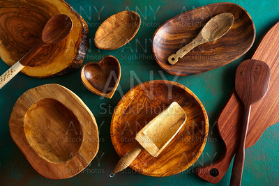 Wooden tableware on grungy green