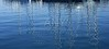 Boats abstract reflexion over blue water