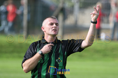 Oct 2006 - Referee Eugene O'Brien points the way in the Bray Emmets v Rathnew Minor Football Championship Final