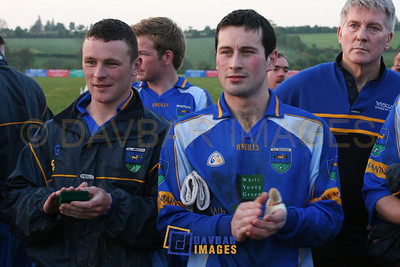 Apr 2005 - Leighton Glynn and Ciaran Hyland listen to the speeches after a challenge match against Louth in Dunlavin