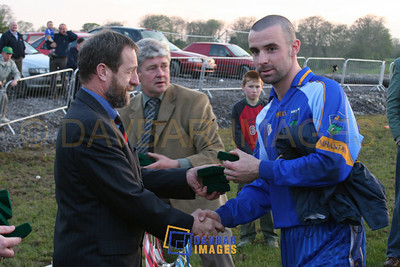 Apr 2005 - Daragh O'Sullivan collects a medal from GAA President Sean Kelly after a challenge match against Louth in Dunlavin