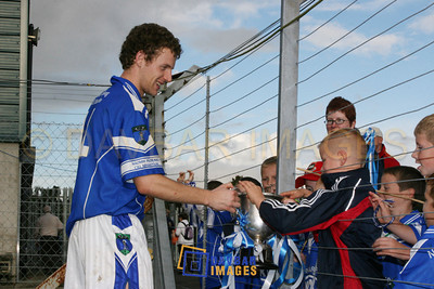 Oct 2006 - St. Patrick's player Paul Earls shows the Miley Cup to the fans