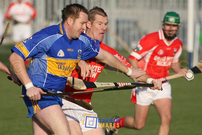 Nov 2006 - Joe Murphy (Carnew Emmets) is challenged by Jonathan O'Neill (Glenealy) in the Dooley Poynton Senior Hurling Final