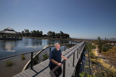 Daniel Glammona, Park Superintendent, on the boardwalk of the pump filled lake which is used for irrigation.  Photo by Paul Kuroda