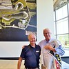 Mr. George Barber and yours truly. He actually personalized one of his Barber Vintage Motorsports banner's he flies on his flag pole to me.