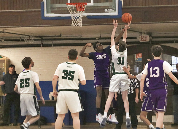MIKE WALSH — THE BERKSHIRE EAGLE<br /> BART Charter senior William Peets blocks a shot in the paint against Eagle Hill in the RVAL Tournament Championship game.