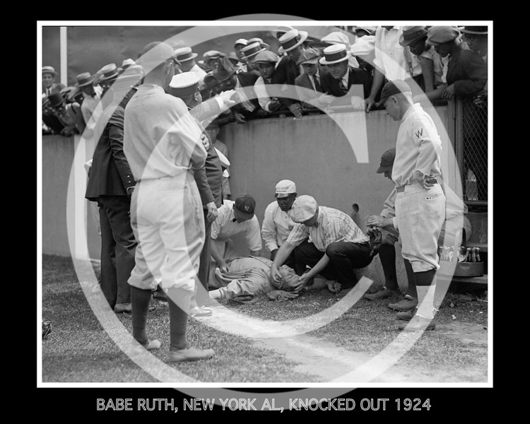 Babe Ruth, New York AL, knocked out 6 July 1924. It happened in the fourth inning, when Babe made a valiant effort for a long foul from Joe Judge's bat, which just sailed over the wall into the crowded seats. The Babe ran into the pavilion parapet with the full force of his body, and dropped unconscious to the grass. Uniformed policemen ran to his assistance and kept back the crowd that seemed disposed to leave the chairs and get a close-up of the injured warrior. Several photographers happened to be on the spot and snapped the Babe as Trainer Doc Woods ran up with the water bucket and the little black bag of first aid preparations.<br /> <br /> At first it was thought that Ruth had been knocked out by a blow from the concrete on his chin, but it was soon discovered that he had been knocked out by a jolt in the solar plexus. His left leg was also hurt at the hip.<br /> <br /> Yankee manager, Miller Huggins, wanted Ruth to quit, but he insisted upon staying in, and got a double in the sixth…