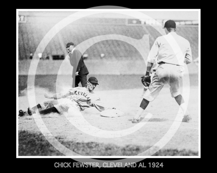 Chick Fewster, Cleveland Indians AL, slides safely into 3rd base during baseball game against Washington Senators AL, 12 July 1924.