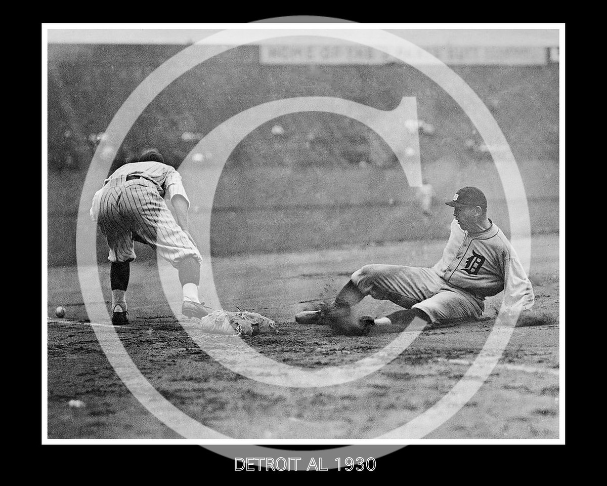 Detroit ball player slides safely into third base as fielder reaches to the left for ball on the ground during baseball game 1930