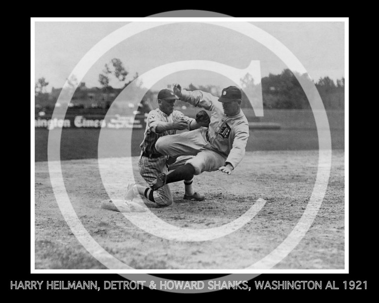 Harry Heilmann, Detroit Tigers AL,  in a poorly executed slide, is tagged out by Howard Shanks, third baseman, Washington Senators AL. Senators beat the Tigers 6-2. 8 June 1921.