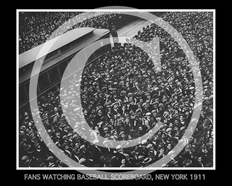 World Series. Huge crowd of baseball fans watching baseball scoreboard during  Game 6  in New York City, 26 Oct 1911.