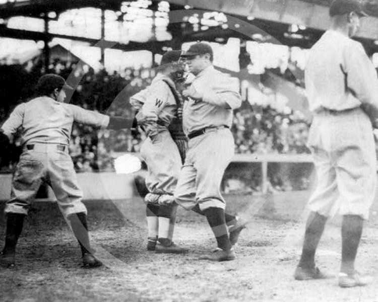 Babe Ruth, New York Yankees AL, crossing the plate after hitting his first home run of the season 21 April 1924.