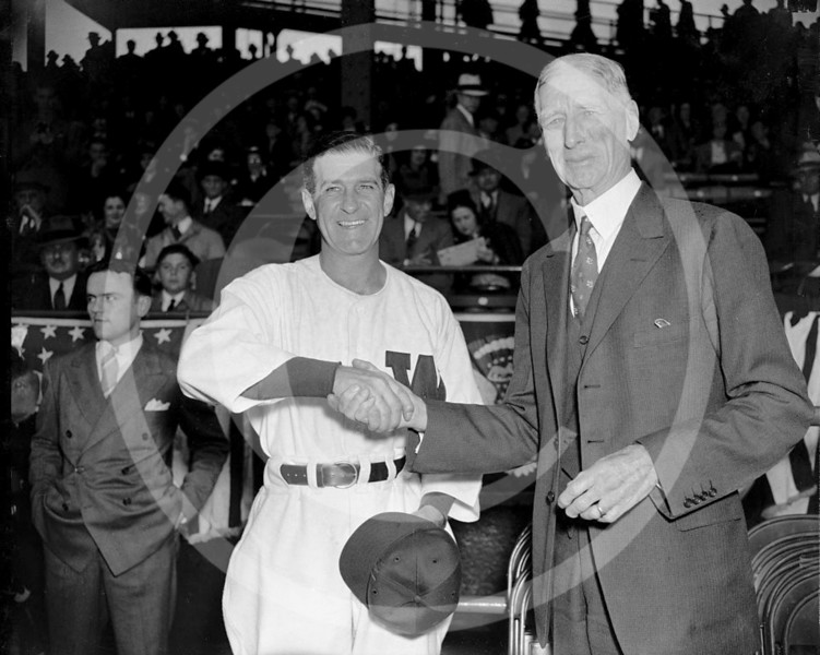 Connie Mack - Bucky Harris, Washington Senators AL and Connie Mack, Philadelphia Athletics AL shake hands prior to their game on Opening Day 1938 .