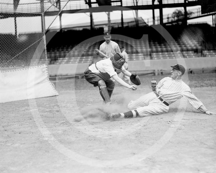 Female baseball player, Ardis Yelton is shown the proper way to slide into a base by a Washington Senators AL, 10 June 1920.