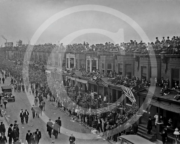 Fans on buildings outside Shibe Park, Philadelphia, during 1913 World Series.