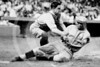 "Edmund John ""Bing"" Miller, Philadelphia Athletics AL, tagged out at home plate by Herold Dominic ""Muddy"" Ruel, catcher, Washington Senators AL, during baseball game, 1925."